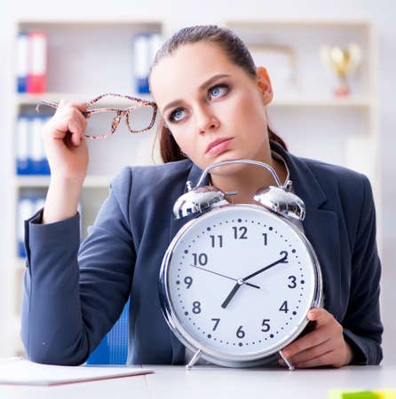 Businesswoman in time management concept Stock Photo