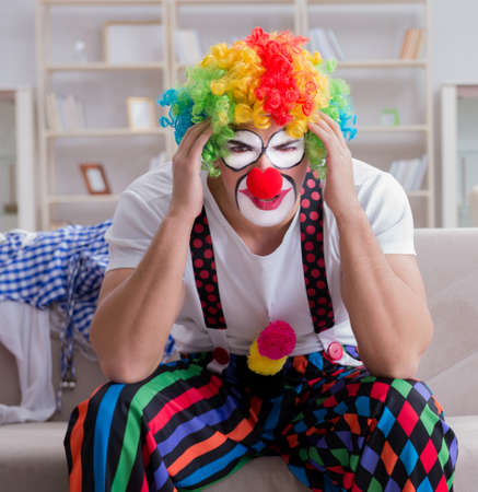 Drunk clown celebrating having a party at home Stock Photo