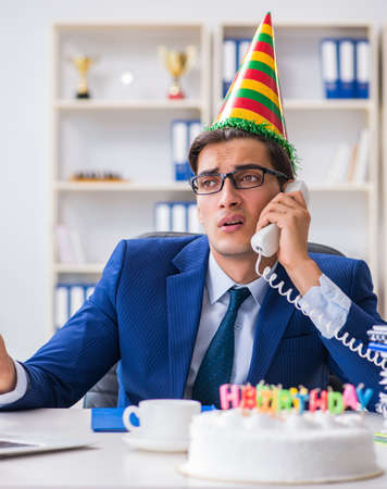 Man celebrating birthday in the office