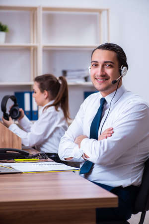 Call center operators working in the office