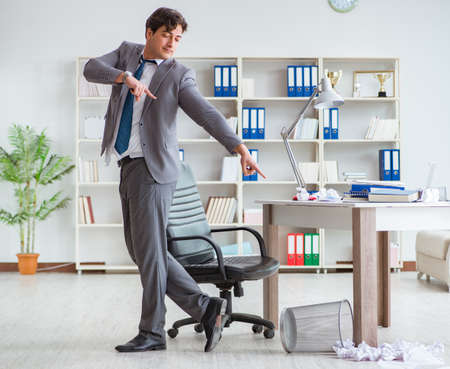 Businessman having fun taking a break in the office at work