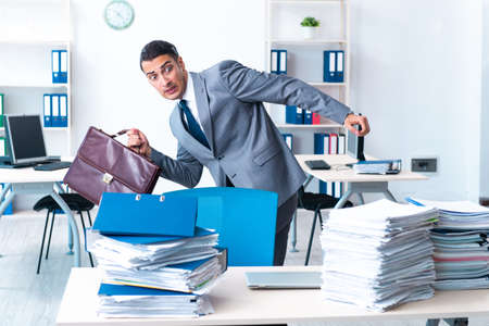 Businessman with heavy paperwork workload