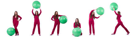 Young woman with ball exercising on white background