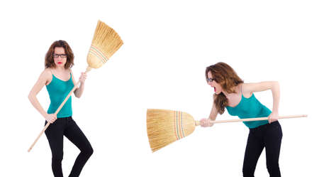 Young woman with broom on white background Фото со стока