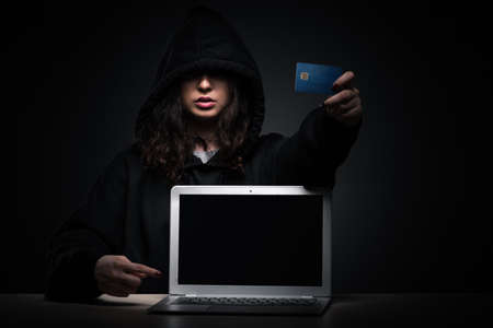 Female hacker hacking security firewall late in office Imagens