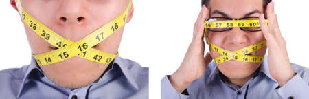Man with centimeter in dieting concept