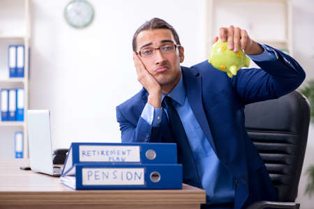 Young male accountant working in the office