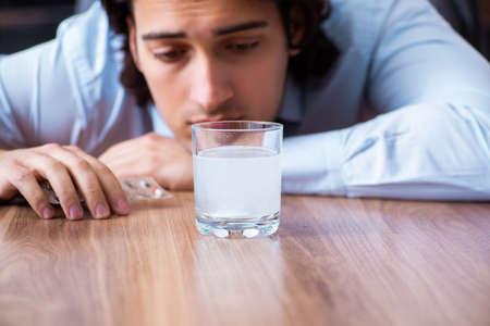 Sick male employee suffering in the office