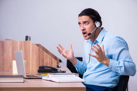 Call center operator working at his desk
