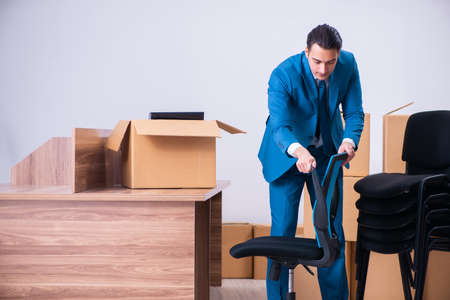 Young handsome businessman being fired from his work