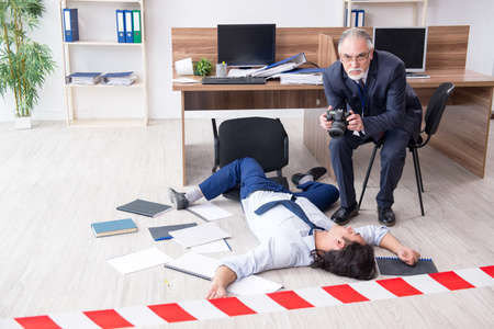 Forensic investigator and dead employee in the office
