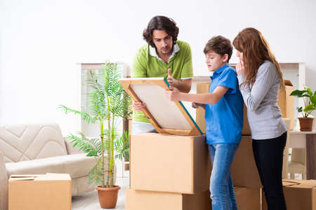 Young family moving to new flat
