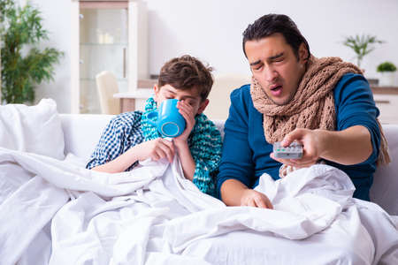 Young father caring for sick son Stock fotó