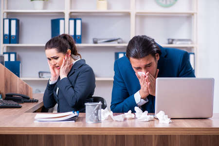 Two employees suffering at workplace