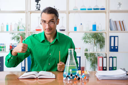 Chemistry student studying for exams Stockfoto