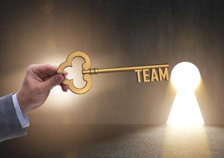 Businessman with key in teamwork concept Фото со стока