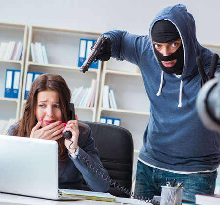 Criminal recording message for ransom with victim businesswoman Stock Photo