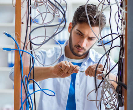 Electrician trying to untangle wires in repair concept Imagens