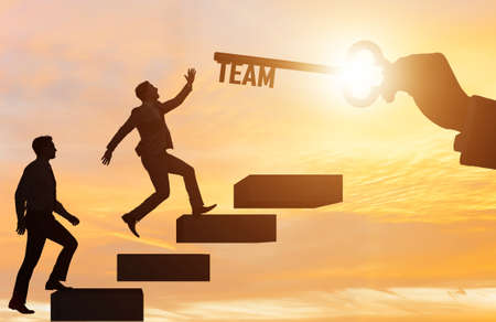 Businessmen on career ladder in teamwork concept