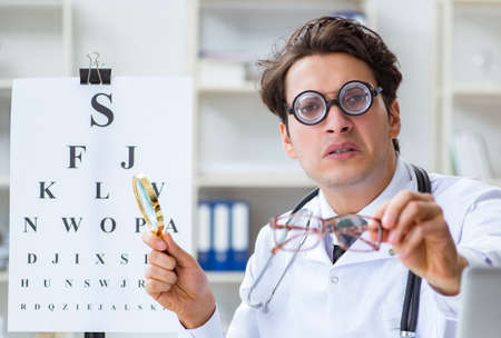 Funny eye doctor in humourous medical concept Stok Fotoğraf