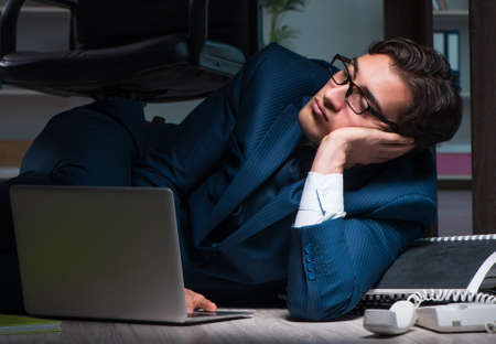 Businessman working overtime long hours late in office Stock fotó - 129926699