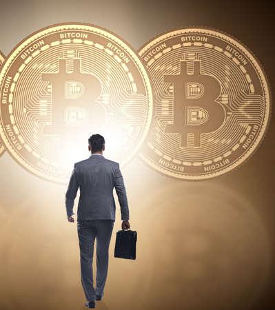 Businessman walking towards bitcoins in cryptocurrency blockchai