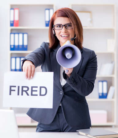 Businesswoman firing people in office Stock Photo