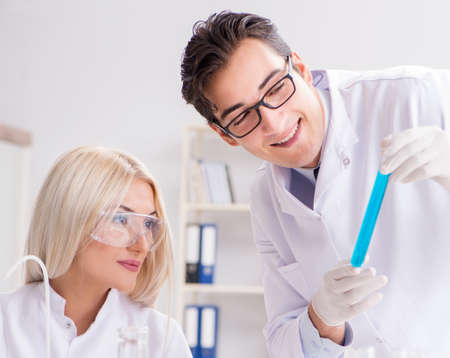 Two chemists having discussion in lab 写真素材