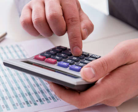 Finance analyst looking and financial reports Stockfoto
