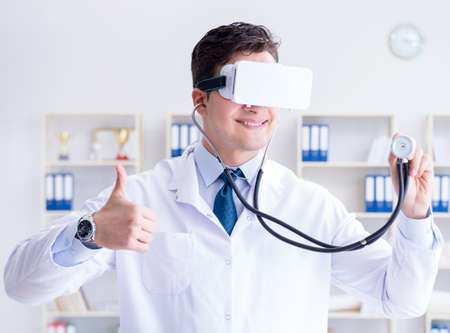 Young doctor with vr virtual reality headset working in the offi 写真素材 - 129990435