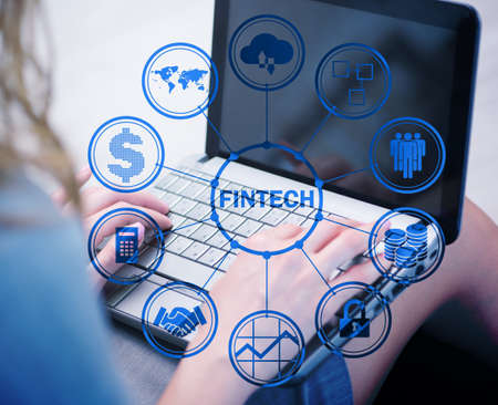 Hands working on laptop in financial technology fintech concept