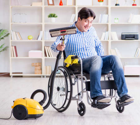 Disabled man cleaning home with vacuum cleaner