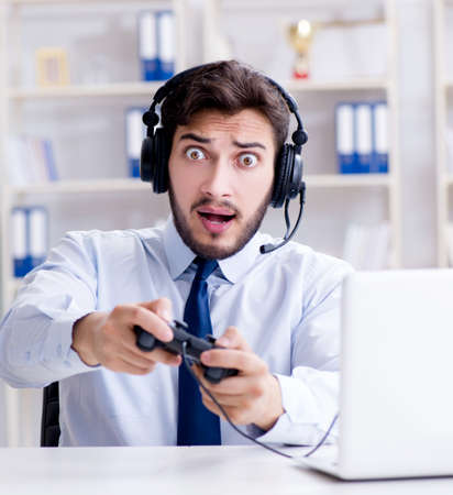 Businessman gamer in office playing games