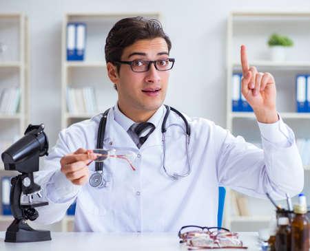 Eye doctor in medical concept 写真素材