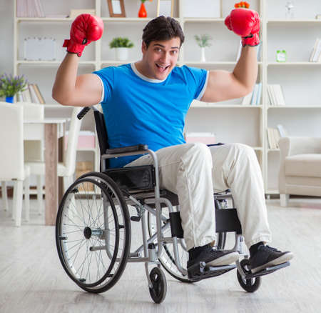 Disabled boxer at wheelchair recovering from injury 写真素材