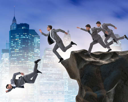 Business people falling off the cliff Stock Photo