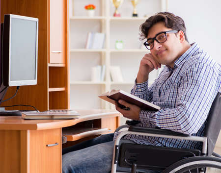Disabled student studying at home on wheelchair 写真素材