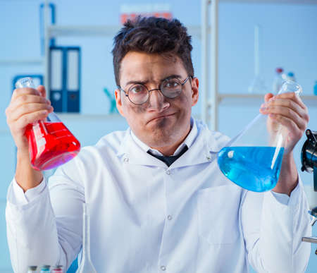 Funny mad chemist working in a laboratory 写真素材
