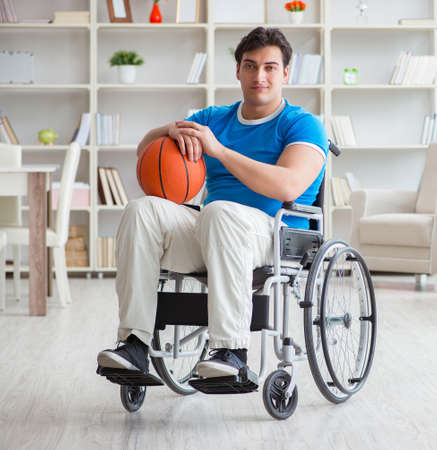 Young basketball player on wheelchair recovering from injury 写真素材