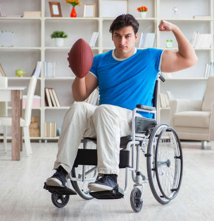 Young man american football player recovering on wheelchair 写真素材
