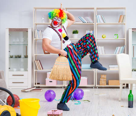 Funny clown doing cleaning at home