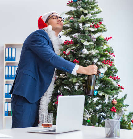 Businessman celebrating christmas holiday in the office Stock Photo