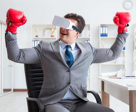 Man boxing in the office with virtual reality goggles