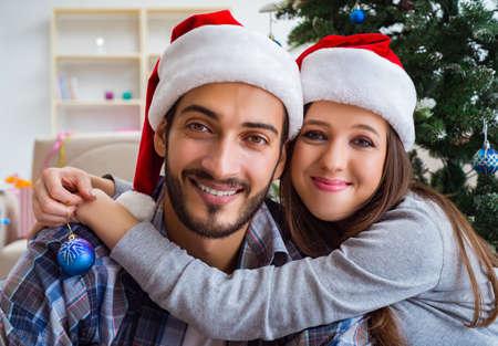 Happy couple hugging during christmas Фото со стока