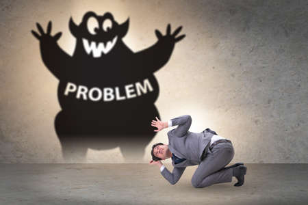 Businessman afraid of big problem Stockfoto
