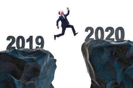 Businessman jumping from year 2019 to 2020