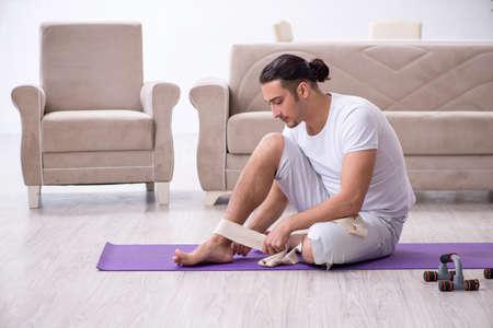 Leg injured man doing exercises at home