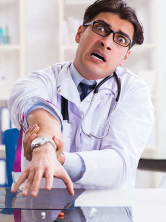 Doctor drug addict in the hospital Фото со стока