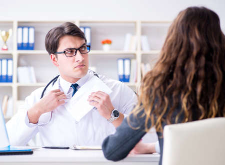 Young doctor in medical insurance fraud concept Stok Fotoğraf - 130528893