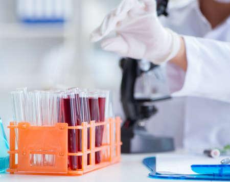 Female scientist researcher conducting an experiment in a labora Stok Fotoğraf